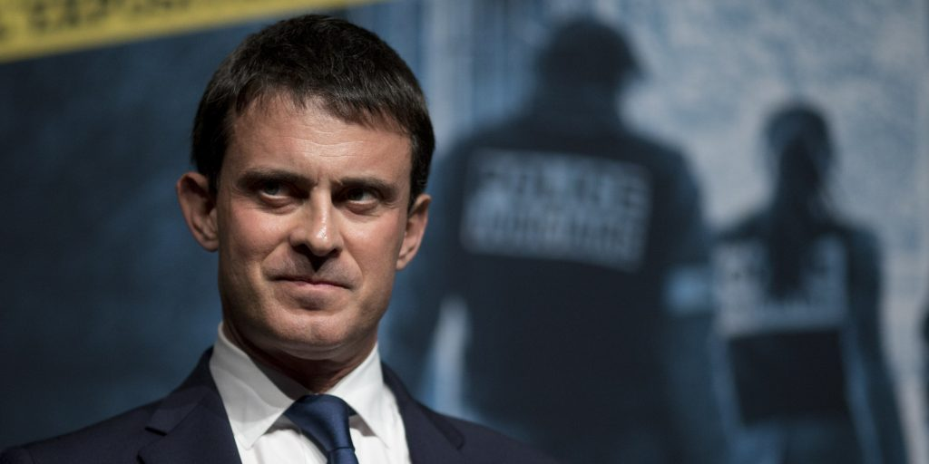 """French Interior minister Manuel Valls is seen as he inaugurates the exhibition """"100 years of the judicial police in Paris"""" on November 08, 2013 in Paris. AFP PHOTO / KENZO TRIBOUILLARD"""